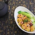Pork & prawn wonton in chili oil with peanut & sesame butter sauce and crispy tofu