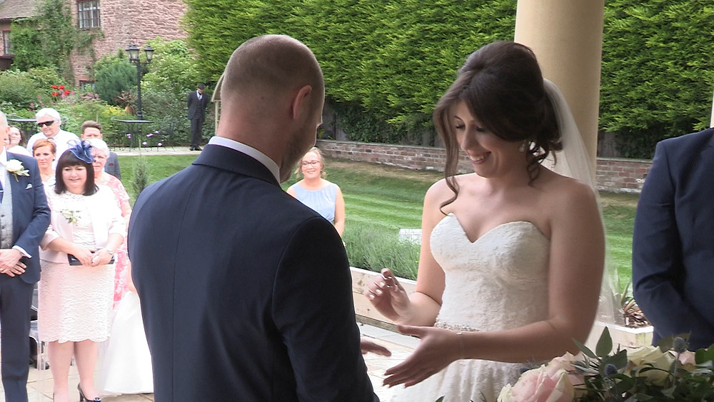 Emma and David exchanging rings