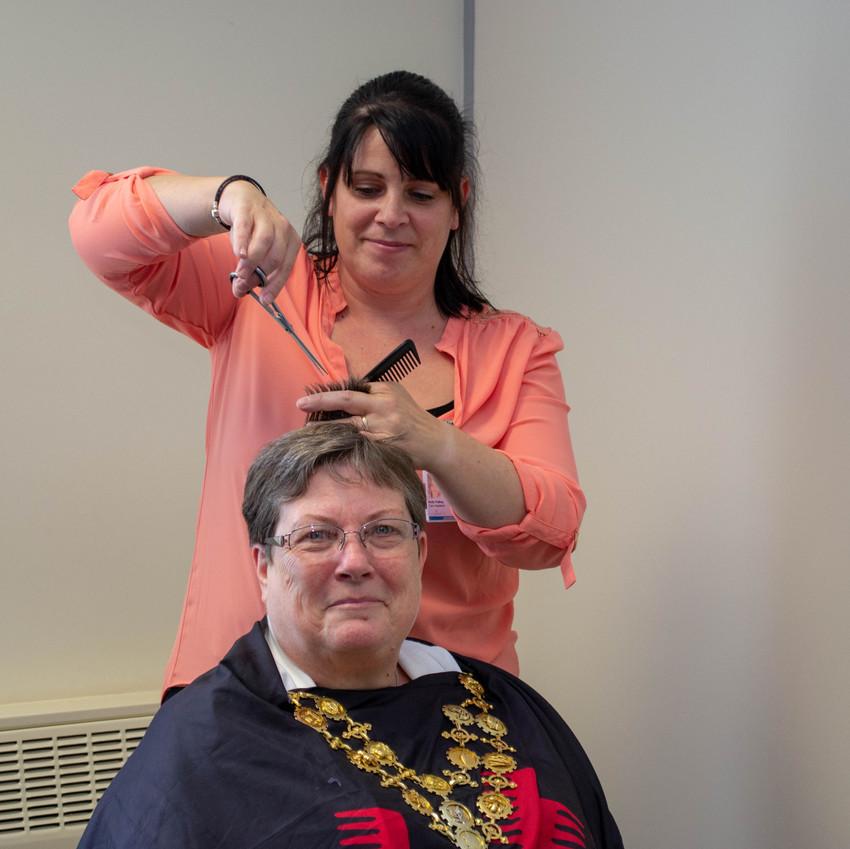 Madam Mayor receiving a haircut