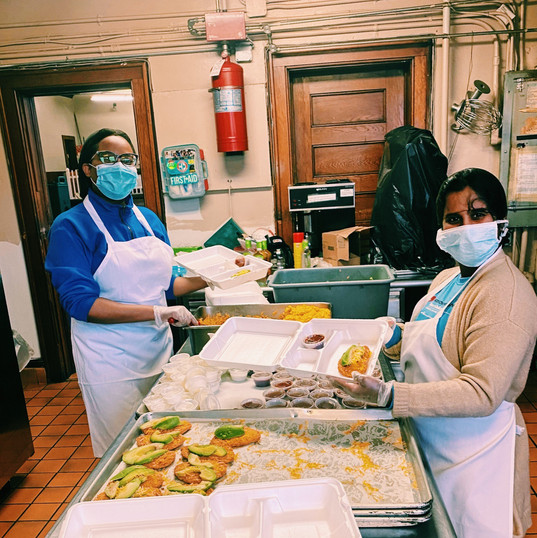 Volunteers from the Guild of St. Margaret's Soup Kitchen prepare a nutritious meal, which the Soup Kitchen offers daily.