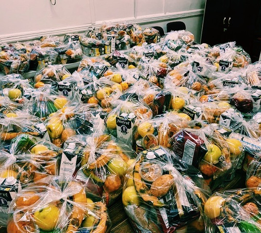 New York Common Pantry delivered 200 baskets of dry goods and fruit for St. James Church, Fordham's food distribution.