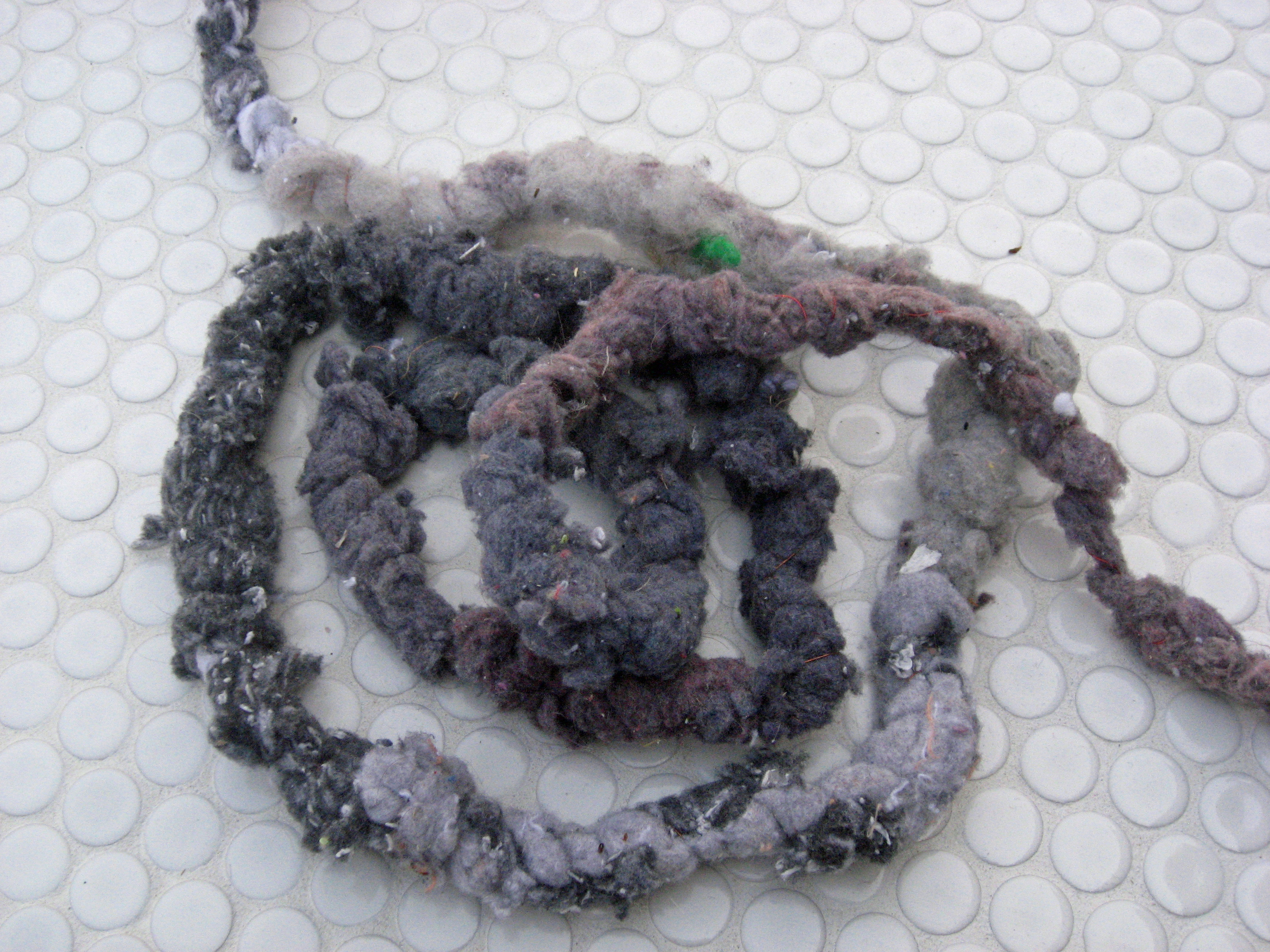 VESSELS, detail of dryer lint cord