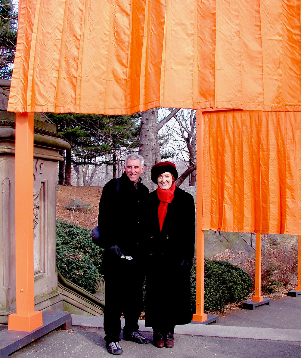 My husband, Ray Greenfield, and I under The Gates.