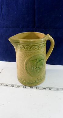 Green Stoneware Cow Pitcher