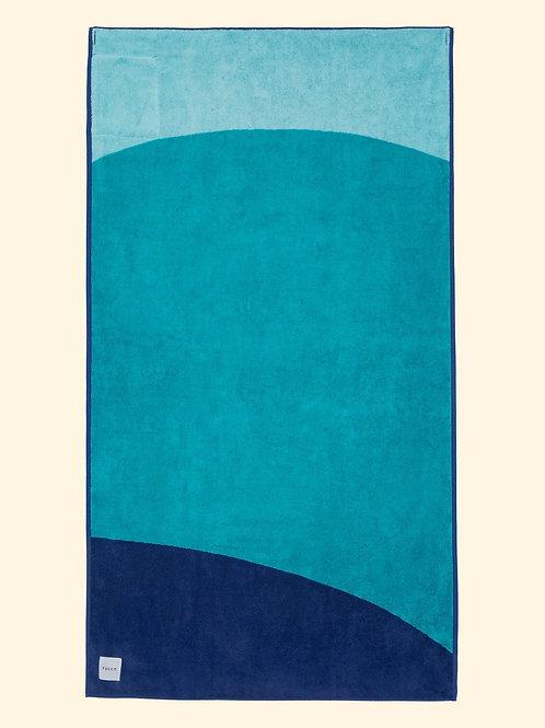 Serviette de plage bleue et turquoise