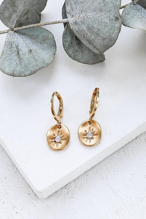 Boucles d'oreille breloque dorés étoilée