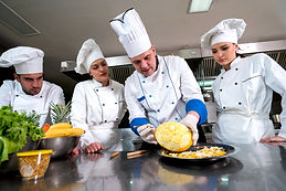 Kitchen chef with young apprentices, tea