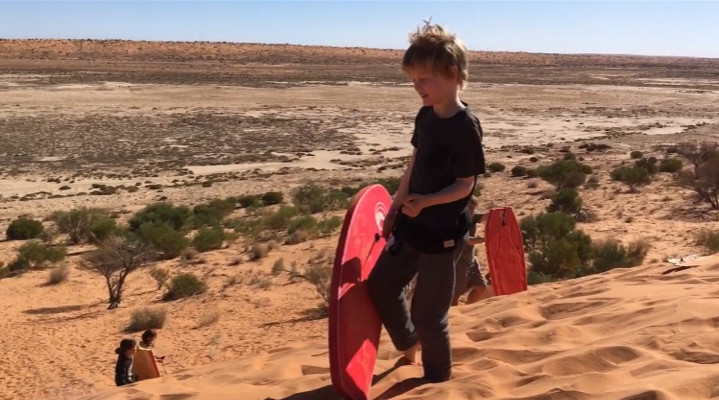 sand boarding down big red