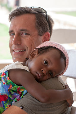 Eric holding sponsered child