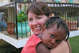 Janet holding sponsored child