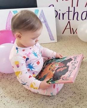 Baby reading book.jpg