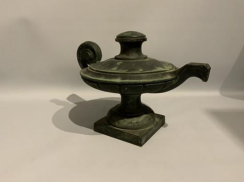 A bronze sculpture of an oil lamp from the XIX century.