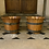 Thumbnail: A pair of cache-pots / planters made out of wood and brass .