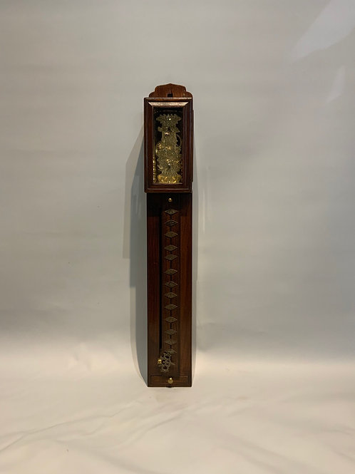 A Japanese Meiji clock in wood and metal.