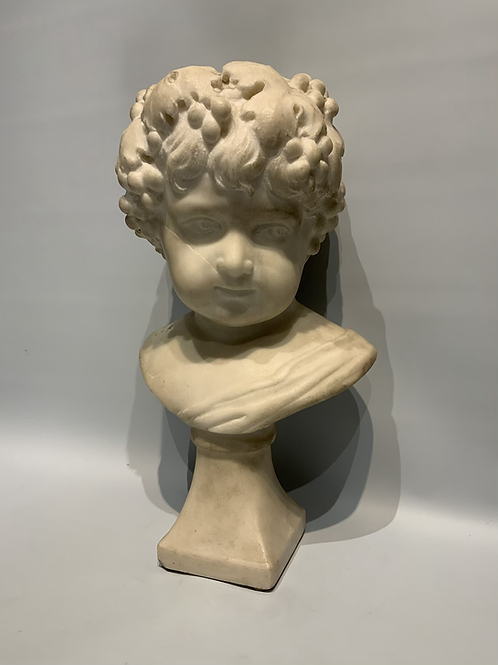 A marble bust representing a child on a marble base .