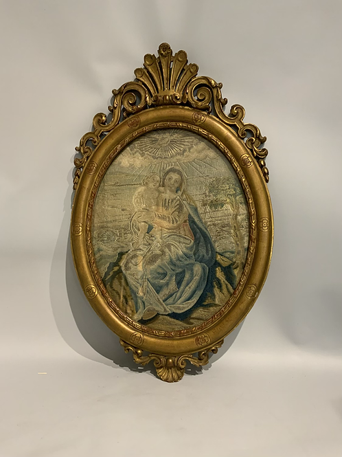 A French embroidery from the XVIII century in a later gilded frame.