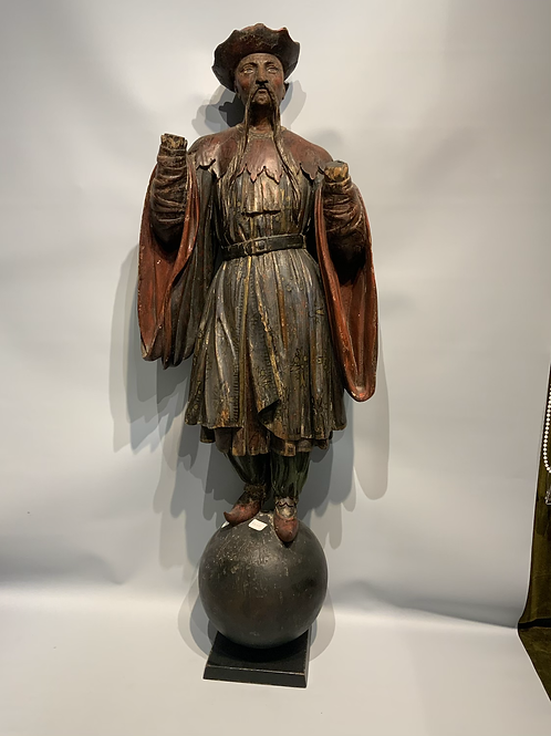 A polychrome wooden carved statue of a Chinese men.
