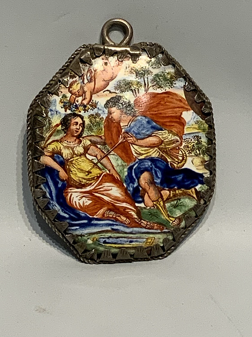 A small enameled and silver framed Spanish mirror in the form of a pendant.