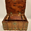 Thumbnail: A wooden colonial box with a drawer and two compartments .