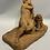 Thumbnail: Terra cotta sculpture of a boy with a dog.
