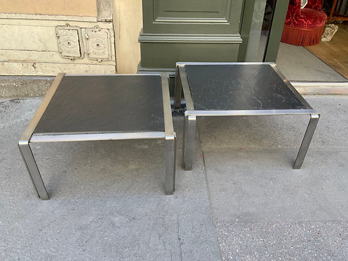 A pair of stainless steel and slate coffee or tea tables from the 1970.