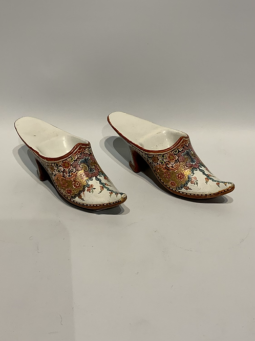 A pair of Dutch Delft ceramic miniature shoes from the XVIII century.