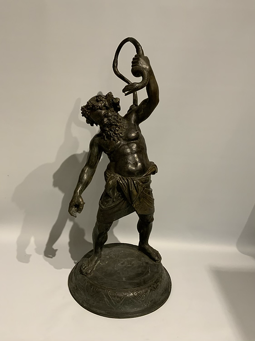 A bronze statue of Silenus and a snake from the 19th century.