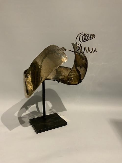 A Dutch folks art head ornament in silver from the XIX century.