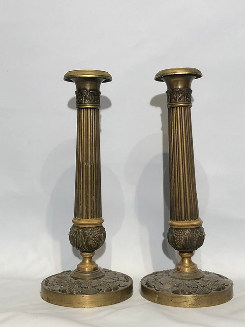 A pair of brass French candlesticks end of the XVIII beginning XIX century.