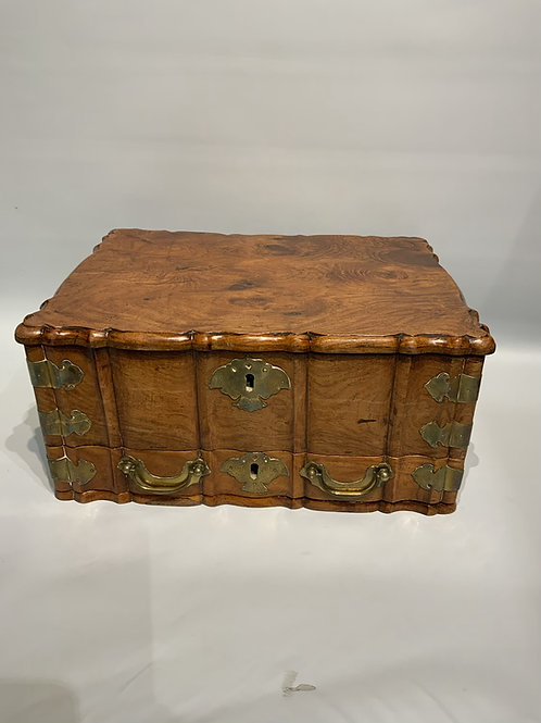 A wooden Dutch colonial traveling box .