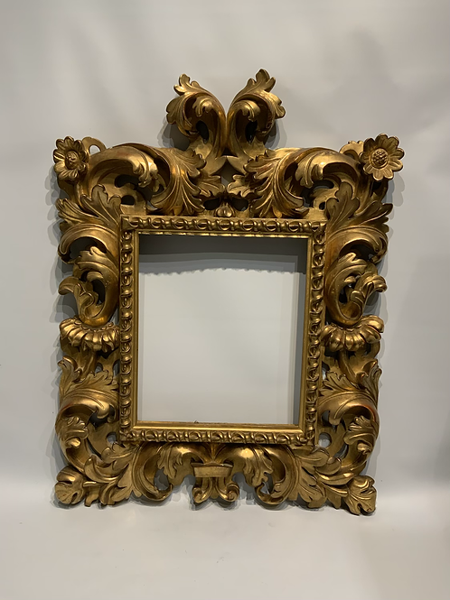 A re gilded wooden frame .