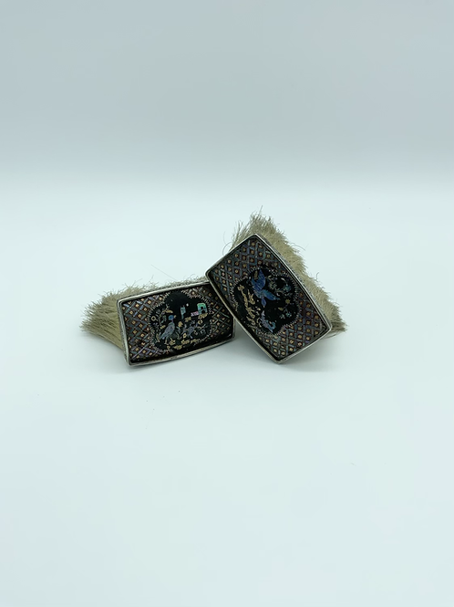 Two silver mounted brushes with lacquer , gold and mother of pearl .
