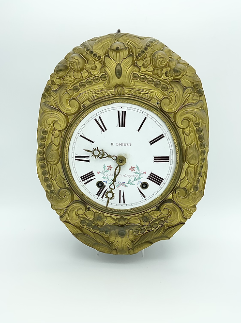 A comtoise clock in iron brass and enamel .