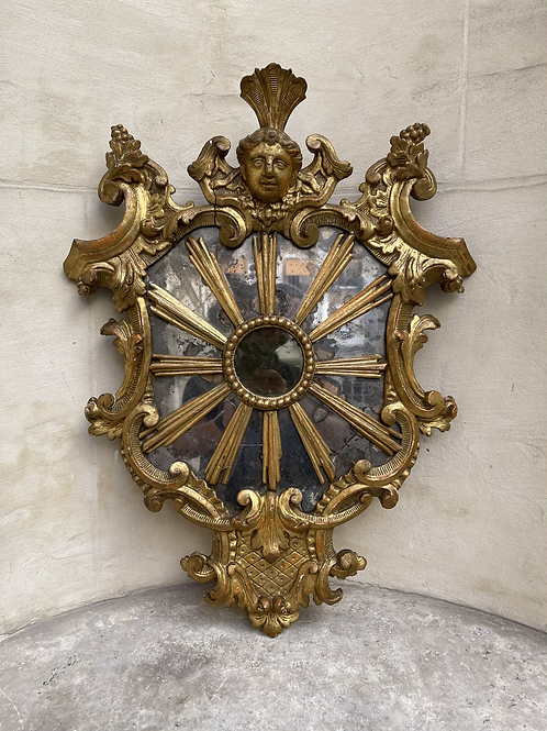 A wood gilded mirror .
