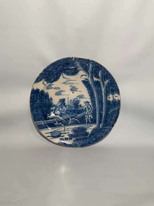 A delft ceramic plate from the XVIII century in blue and white.
