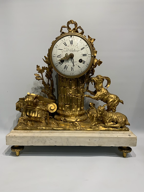 A French Louis XVI gilded bronze mantel clock .