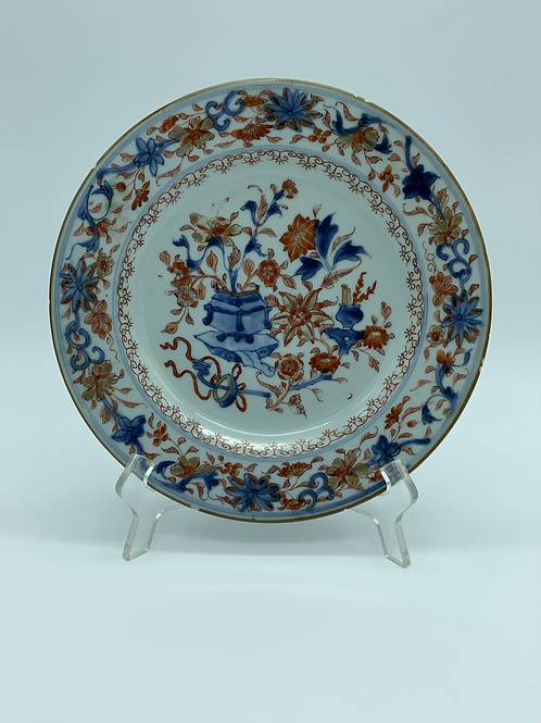 A polychrome porcelain plate from the XVIII century .