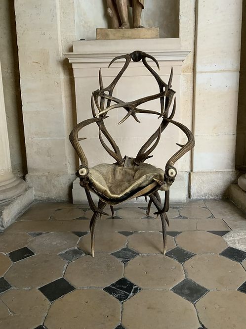 An antler chair from the second half of the XIX century .