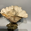 Thumbnail: A pair of small shells on a bronze base .