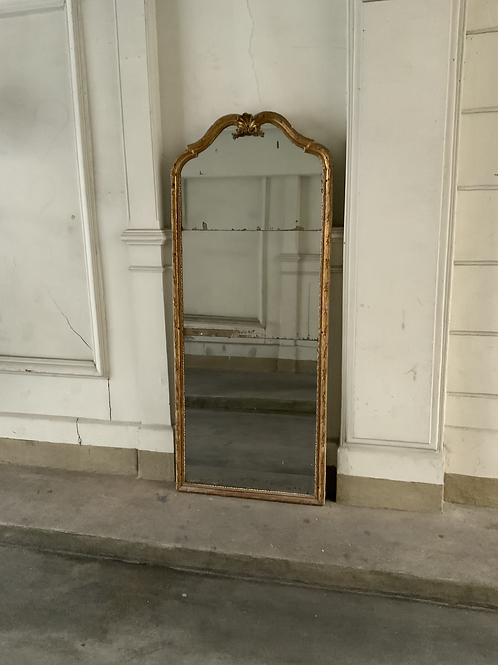 A large French gilded wooden mirror from the first half of the XVIII century .
