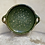 Thumbnail: A green lead glazed strainer made in earthenware .