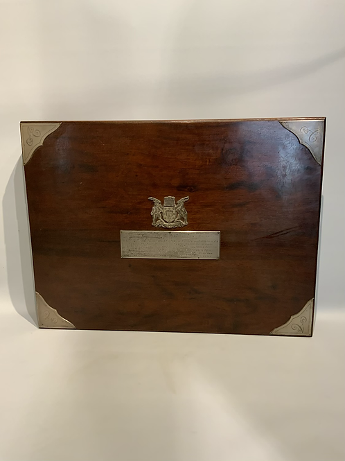 A South African box in the shape of a book .