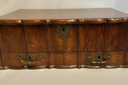 A large wooden Dutch colonial traveling box .