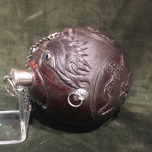 A sculpted Coconut powder flask with silver mounting 18th century