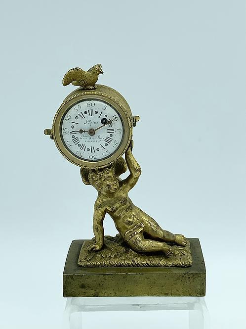 A small bronze gilded clock .