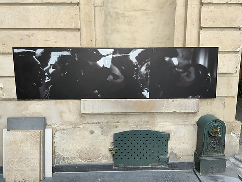 Photo print on translucent panel showing three images from Alfred Hitchcock film