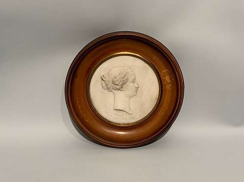 Plaque in biscuit with a wooden frame XIX century.
