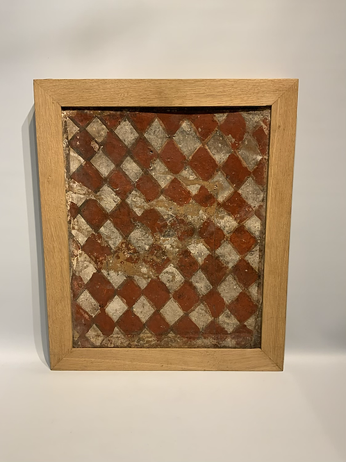 A large ceiling tile made from earthware.