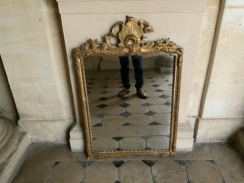 A French XVIII century gilded mirror in wood.