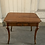Thumbnail: A wooden table with four drawers .